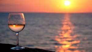 Glass of rosé wine at sunset